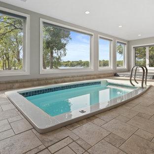 Imagen de piscinas y jacuzzis alargados, clásicos, extra grandes, interiores y rectangulares, con suelo de baldosas