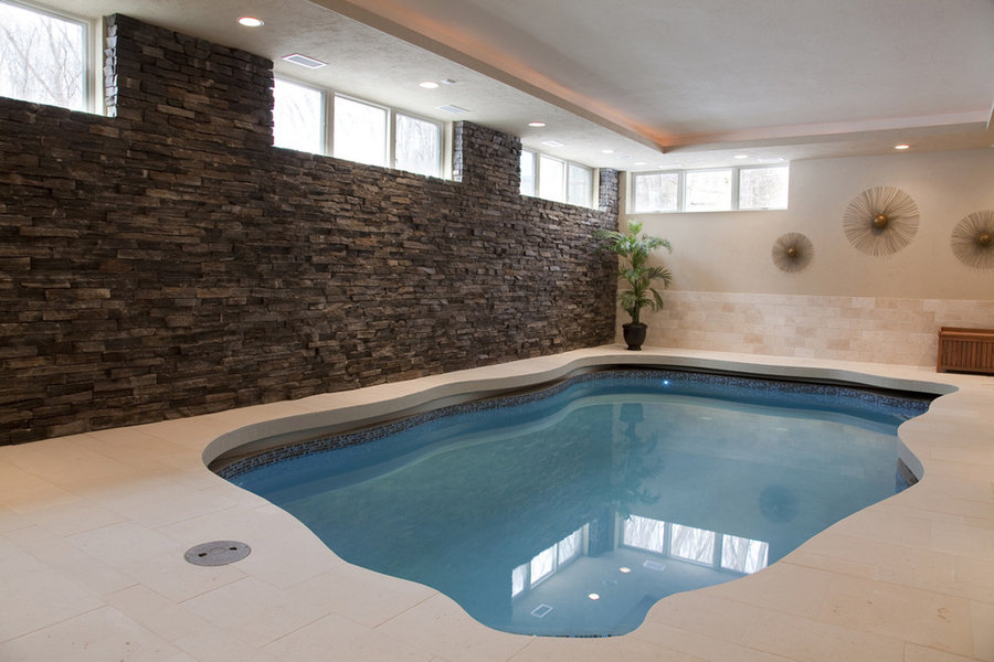 Indoor pool addition with sun room and patio over the pool