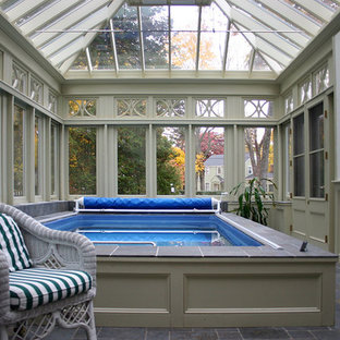 Design ideas for a small traditional indoor rectangular aboveground pool in Other with a pool house and natural stone pavers.