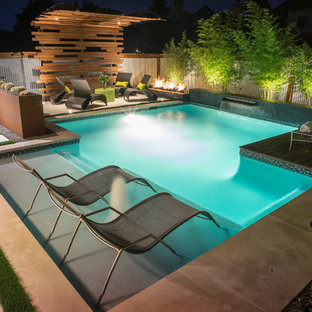 Inspiration for a small industrial backyard rectangular pool in Dallas with concrete pavers.