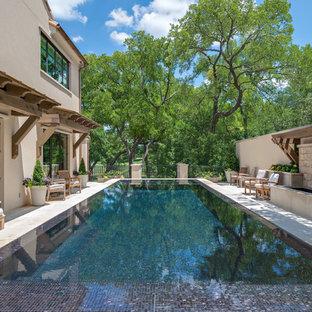 Pool - large mediterranean backyard rectangular pool idea in Dallas