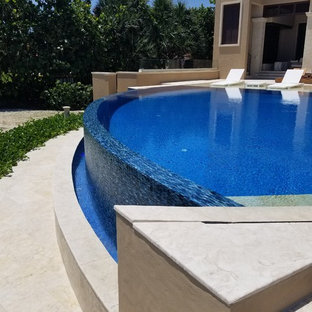 Infinity Edge Custom Shaped Pool with Sun Shelf in Stuart, Florida
