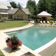 Traditional Pool by Armond Aquatech Pools