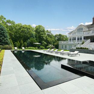 Imagen de piscinas y jacuzzis infinitos, clásicos renovados, grandes, rectangulares, con adoquines de piedra natural