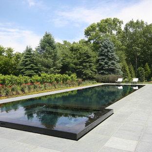 Großer Klassischer Infinity-Pool in rechteckiger Form mit Natursteinplatten in New York
