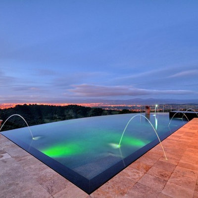 Mid-sized trendy backyard rectangular and stone infinity pool fountain photo in San Francisco