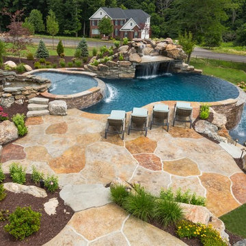 Infinity Edge Pool with Sun Ledge, Grotto, Waterfall & Floating Steps