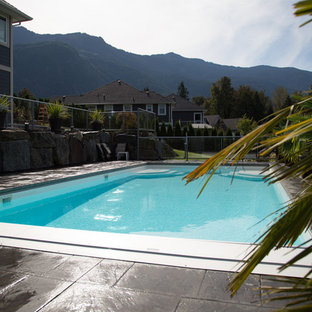 Inspiration for a large modern backyard stamped concrete and rectangular lap pool remodel in Vancouver