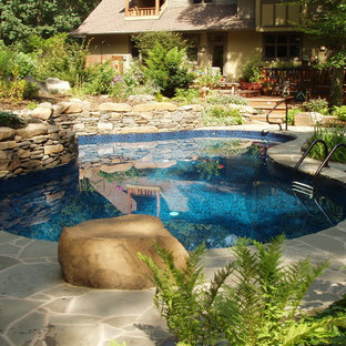 Mid-sized eclectic backyard custom-shaped pool in Philadelphia with natural stone pavers.