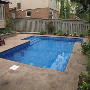 Inspiration for a small traditional backyard rectangular pool in Toronto with stamped concrete.
