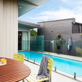 Photo of a contemporary backyard rectangular lap pool in Sydney.