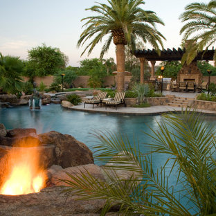 Inspiration for an expansive world-inspired custom shaped natural swimming pool in Phoenix.