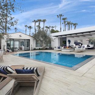 Imagen de piscina infinita, marinera, rectangular, en patio trasero
