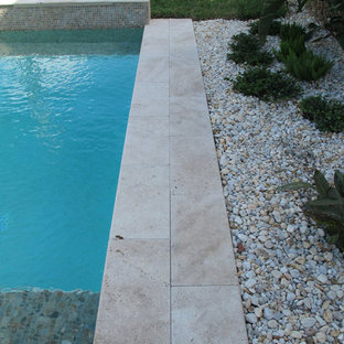 Ivory Tumbled Travertine Pavers and Pool Coping