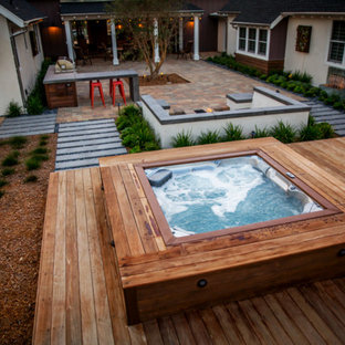 This is an example of a contemporary back swimming pool in San Francisco with a hot tub.