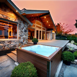 Example of a small mountain style backyard rectangular aboveground hot tub design in Tampa with decking