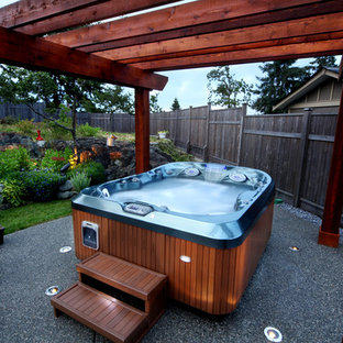 This is an example of a small modern backyard custom-shaped aboveground pool in Las Vegas with a hot tub and decomposed granite.