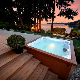 Mid-sized arts and crafts backyard rectangular aboveground hot tub photo in Portland with decking