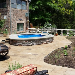 Hot tub - mid-sized rustic courtyard concrete paver and custom-shaped aboveground hot tub idea in Other