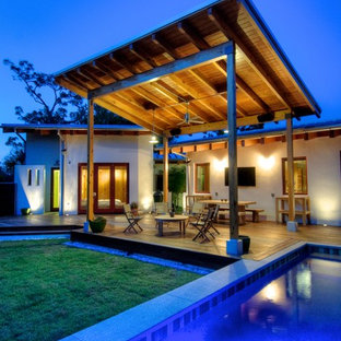Inspiration for a large country backyard rectangular lap pool in Tampa with decking.