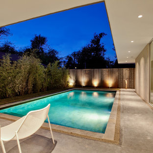 Inspiration for a mid-sized modern concrete and rectangular pool remodel in Dallas