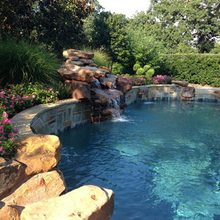 Pool fountain - large rustic backyard custom-shaped natural pool fountain idea in Houston with decking