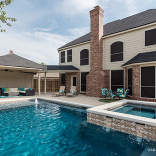 Photo of a medium sized romantic back custom shaped swimming pool in Houston with concrete slabs.