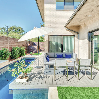 Inspiration for a contemporary backyard rectangular lap pool fountain remodel in Dallas