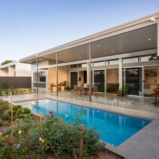 Inspiration for a contemporary rectangular pool in Sunshine Coast with tile.