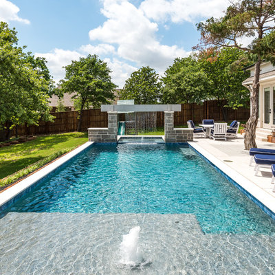 Inspiration for a contemporary backyard concrete and rectangular lap pool fountain remodel in Dallas