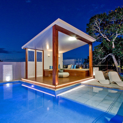Inspiration for a mid-sized modern backyard stone and custom-shaped aboveground pool house remodel in Brisbane