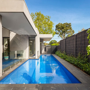 Inspiration for a contemporary l-shaped pool in Melbourne with natural stone pavers.
