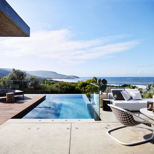 Contemporary l-shaped pool in Sydney with decking.