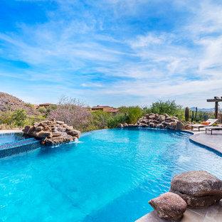 Mountain style pool photo in Phoenix
