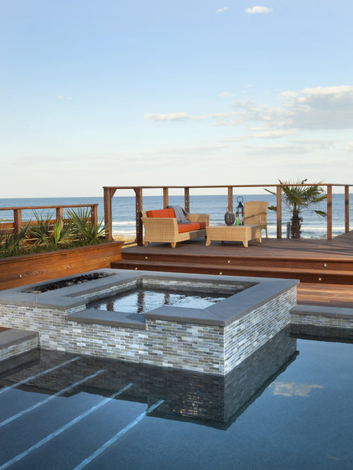 Pool Waterline Tile Ideas glass tile pool waterline Example Of An Island Style Pool Design In Wilmington With A Hot Tub And Decking