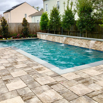 L-Shaped Pool with Stone Deck