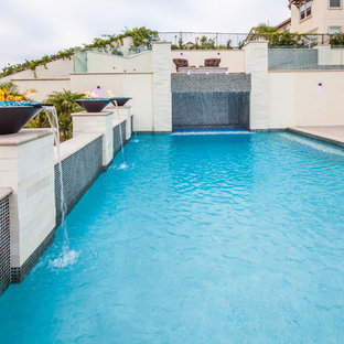 Mid-sized minimalist backyard concrete and rectangular pool fountain photo in San Diego
