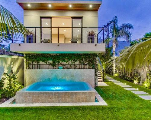 Fotos de piscinas dise os de casas de la piscina y for Piscina elevada rectangular