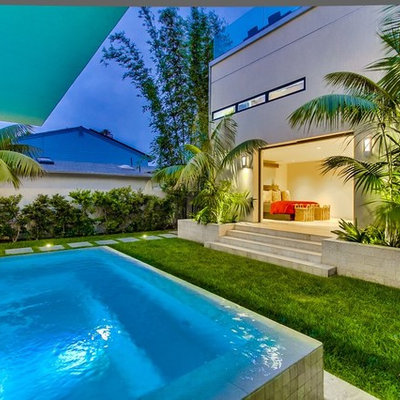 Inspiration for a small contemporary backyard tile and rectangular aboveground pool fountain remodel in San Diego