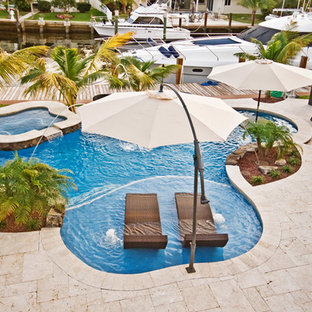 Lagoon/Freeform Pool With Sun Shelf and Bar Area in Fort Lauderdale