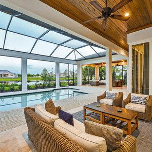 Imagen de piscina alargada, actual, grande, interior y rectangular, con adoquines de ladrillo