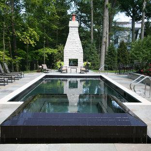 Idée de décoration pour une piscine arrière tradition rectangle et de taille moyenne avec des pavés en pierre naturelle.