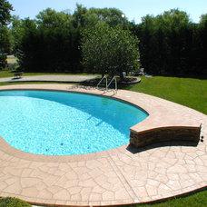 Traditional Pool by Unique Concrete
