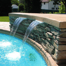 Traditional Pool by Unique Concrete