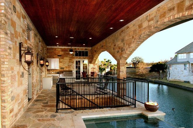Traditional Pool by Zbranek & Holt Custom Homes