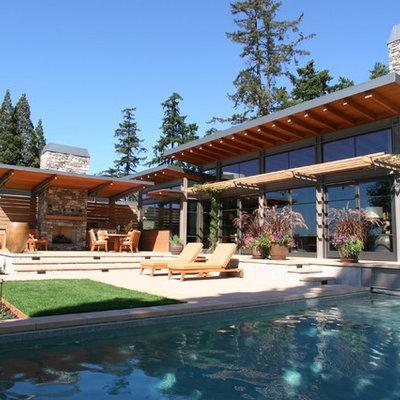 Large trendy backyard concrete paver and rectangular lap hot tub photo in Seattle