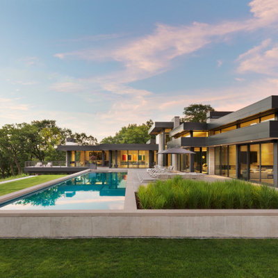 Inspiration for a contemporary custom-shaped lap pool remodel in Minneapolis