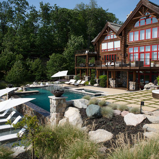 Inspiration for a rustic backyard concrete paver and rectangular pool remodel in Grand Rapids