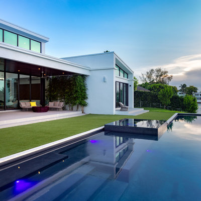 Inspiration for a contemporary backyard custom-shaped lap hot tub remodel in Miami