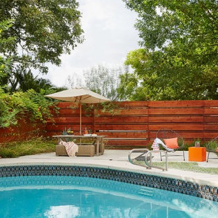 Design ideas for a large eclectic front yard pool in Dallas with tile.